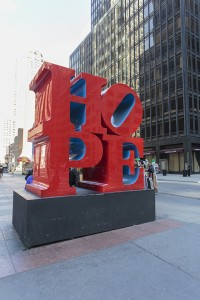 "New York City, United States - March 12, 2016: public art piece: ""Hope"" sculpture by american artist Robert Indiana on the corner of 7th Avenue and 53rd Street in Midtown Manhattan"
