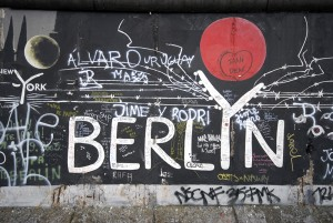 """Berlin, Germany - February 14. 2007: Berlin Wall. East Side Gallery. Graffiti on one of the sections of the Berlin wall."""