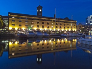London, England - August 16, 2010: St. Katharine Dock at dusk. The former docklands and industrial areas of London have been transformed into modern marinas with restaurants, apartments, offices and leisure facilities.