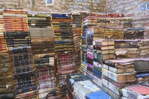Venice, Italy - April 14, 2016: .Book store steps made from old books at the high water book store in Venice. You can climb the books to look into the adjacent canal