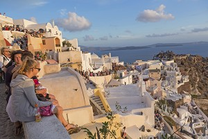 Santorini, Greece - October 12, 2015: Tourists watching the sunset at Oia in Greece