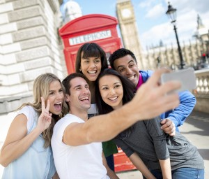 Group of happy friends taking a picture in London