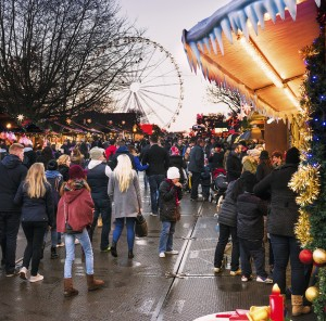 London, UK - December 5, 2014: People browsing market stalls at the Winter Wonderland Christmas markets in Hyde Park in central London.