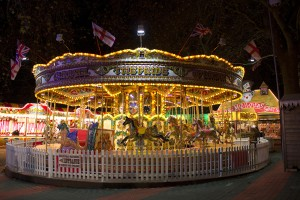 London, England - November 28 2014: Crowds enjoy the rides and attractions of the famous Winter wonderland.