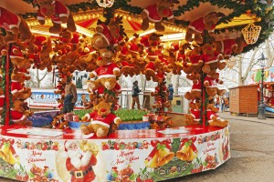 """London, United Kingdom - January 4, 2013: Win a Santa fairground stall at the Winter Wonderland event in Hyde Park London, england. The stall holders in the back of the stall and some visitors are in the background."""
