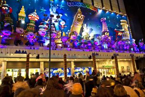 Madrid, Spain - December 20, 2010: People have fun in Christmas time watching the famous puppet show and illumination at center El Corte Ingles in Madrid, Spain.