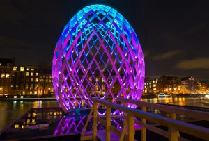 Amsterdam, The Netherlands - December 12, 2012: Amsterdam at night with illuminated egg (OVO) during the Amsterdam Light Festival.