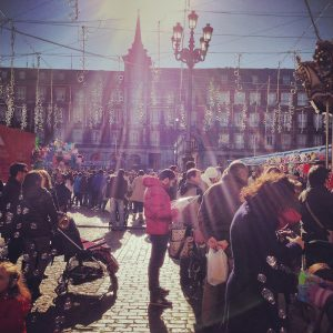Madrid, Spain - December 22, 2013: Crowds visiting Christmas Market on Plaza Mayor, Madrid