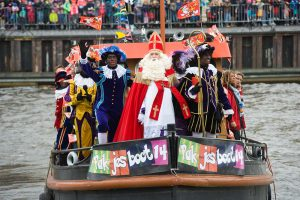 Enschede, The Netherlands - Nov 14, 2015: The dutch Santa Claus called 'Sinterklaas' is arriving with his help Black Pete on a steamboat in a harbor in Holland.