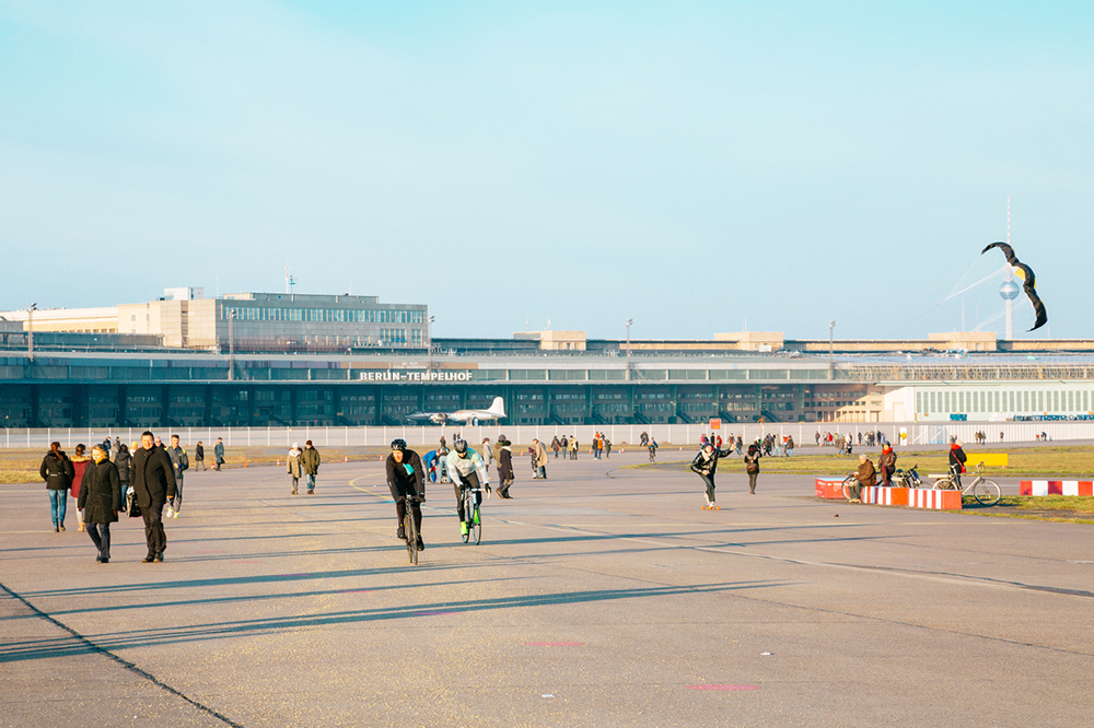 Berlin, Germany - January 1, 2015: Cycling and other sporting activities taking place in Tempelhof Airport, Berlin, Germany. The airport ceased operation in 2008 and is now used for sports and events.