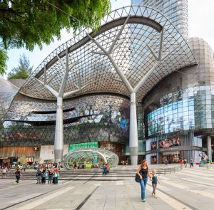Singapore, Republic of Singapore - May 7, 2016: People shopping on Orchard road. Amazing architecture of ION Orchard shopping complex