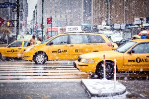 """New York City, USA - January 7, 2011: Yellow Taxi cars cautiously maneuvering through a blizzard on Eight Av. Winter 2010-2011 was very snowy in New York"""