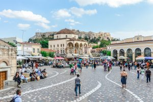 Athens, Greece - June 9, 2016: Monastiraki is a flea market neighborhood in the old town of Athens, Greece, and is one of the principal shopping districts in Athens. The area is named after Monastiraki Square, which in turn is named for the Church of the Pantanassa that is located within the square. Photo taken durign the day and contains many locals and tourists visiting the square.