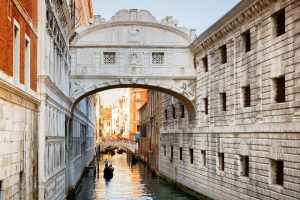 Venice, Italy - August 24, 2014: View of the Bridge of Sighs (Ponte dei Sospiri) and the Rio de Palazzo o de Canonica Canal from the Riva degli Schiavoni in Venice, Italy. The Ponte de la Canonica is visible in background.