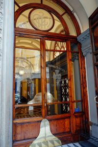 Florence,Italy - March 7, 2016: The main entrance of the Santa Maria Novella pharmacy in Florence Italy Established 600 years ago by Florentine monks