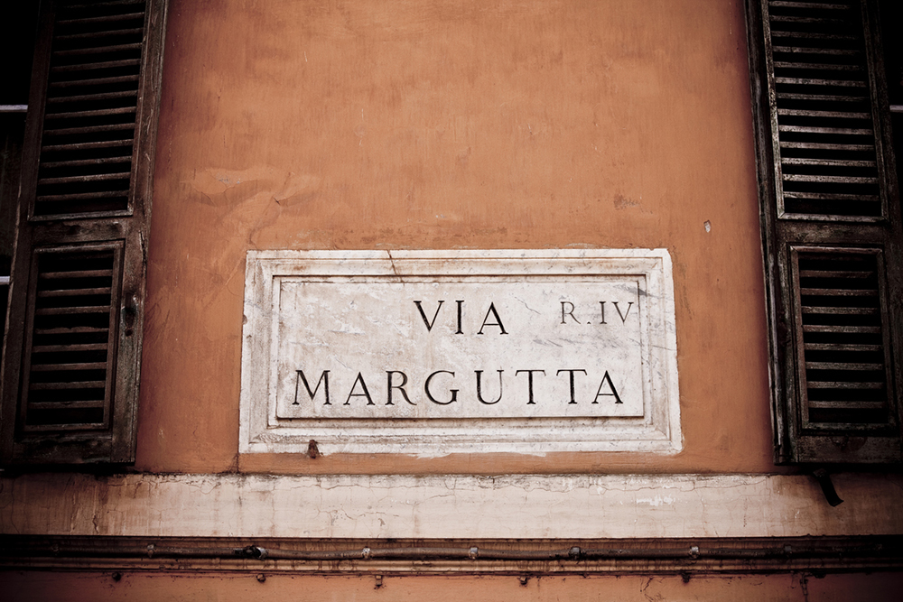 """Street sign of small exclusive road in Rome a residence of many famous people, like film director Federico Fellini. On this street was filmed part of a movie """"Roman Holiday"""". Canon 1Ds Mark III"""