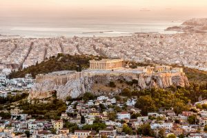 Aerial view over the City of Athens with famous Acropolis at Sunset. Athens, Greece.